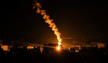 An flare fired by Israeli forces lights the sky above the town of Rafah in southern Gaza on Sunday.