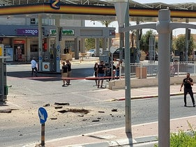 The site where a rocket fell near a gas station in Netivot, today.