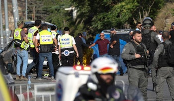 Israeli forces and emergency teams at the scene of a suspected car-ramming attack in Jerusalem's Sheikh Jarrah, today.