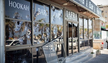 Shattered windows at an Arab-owned business in Bat Yam, in central Israel.