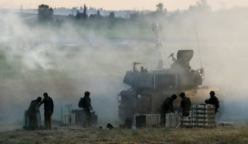 IDF soldiers on the Gaza border, today.