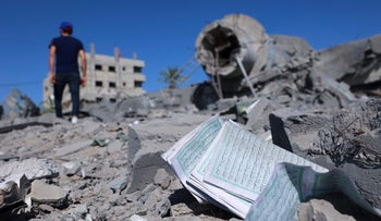 Palestinian men salvaging documents and copies of the Koran from the rubble of the Qlebo mosque at the Jabalya refugee camp in the northern Gaza Strip after Israeli airstrikes last week.