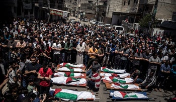 Palestinians attend the funeral of two women and eight children of the Abu Hatab family in Gaza City, who were killed after an Israeli air strike, Saturday.