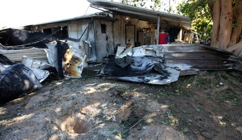 The shack that was home to Thai migrant workers, after it was hit by a rocket launched from the Gaza Strip, on Tuesday.