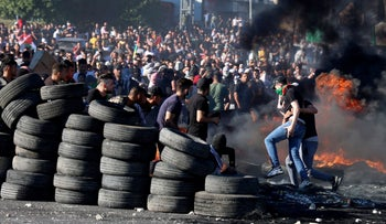 Palestinian protesters confront Israeli troops at the Hawara checkpoint south of Nablus city in the West Bank.