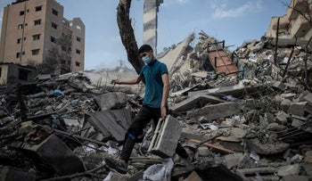 A Palestinian man on Tuesday at a building destroyed by an Israeli airstrike in Gaza City.