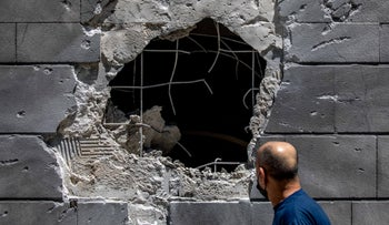 A man observing the damage by a rocket attack to a parking garage in Ashkelon last week.