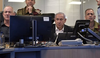 Prime Minister Benjamin Netanyahu (center), Chief of General Staff Aviv Kochavi (right) and Defense Minister Benny Gantz (left) at the Israeli air force offices during a military airstrike overnight Friday.