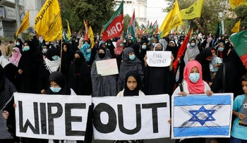 Shi'ite Muslim supporters of the Imamia Student Organization march in solidarity with the Palestinians and to protest Israel in Karachi, Pakistan, this month