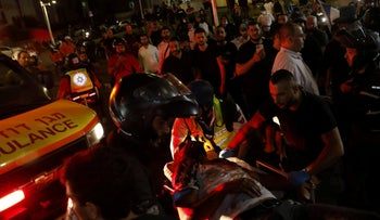 Israeli paramedics evacuate an Arab Israeli man after an attempted lynch by Jewish rioters in Bat Yam,  today.