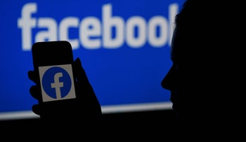 A smartphone screen displaying the Facebook logo last month.