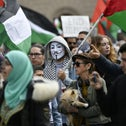 People holding placards and waving Palestinian flags marching in solidarity with Palestinians during a demonstration in Malmo last weekend.