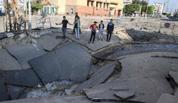 A crater in a Gaza City street following Israeli airstrikes, last week.