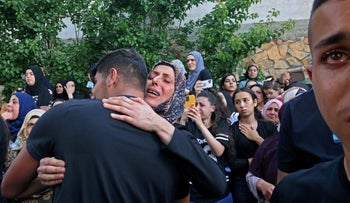 Mourners during Mohammed Kiwan's funeral in Umm al-Fahm, on Thursday.