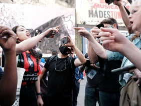 Pro Palestinian protesters face off with a group of Israel supporters and police in a violent clash in New York City, yesterday.
