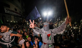 Palestinians celebrate in the streets following a ceasefire with Israel, May 2021.