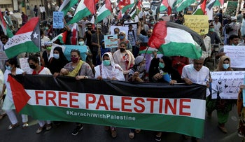 People take part in a rally in support of Palestinians, in Karachi, Pakistan, Thursday, May 2021.
