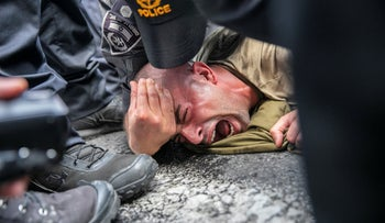 Police restrain a protester during a demonstration calling for better treatment of disabled army veterans, last month in Tel Aviv.