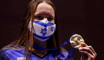 Israel's Anastasia Gorbenko celebrates with her gold medal after winning the women's 200 meters individual medley finals at the European Aquatics Championships in Budapest, on Saturday.