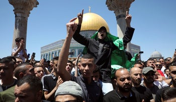 A Muslim worshipper wears a Hamas flag during a protest following Friday prayers at the Al-Aqsa Mosque, earlier this month.