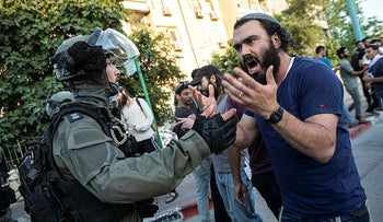 Israeli riot police tries to block a Jewish right-wing man in Lod, central Israel, May 2021.