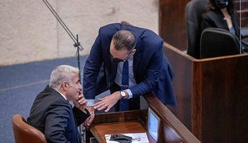Yair Lapid, left, in the Knesset on Monday.