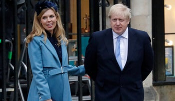 Britain's Prime Minister Boris Johnson (R) with his partner Carrie Symonds in London, 2020.