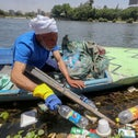 Fisherman Mohamed Nasar uses his boat to collect plastic garbage from the Nile river in Giza, Egypt.