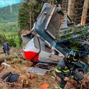 Rescuers work by the wreckage of a cable car after it collapsed near the summit of the Stresa-Mottarone line in the Piedmont region, northern Italy, earlier this week.