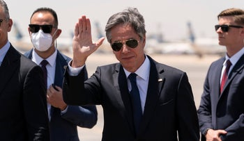 Secretary of State Antony Blinken steps off his plane upon arrival at Cairo International Airport, on Wednesday.