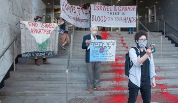 69-year-old David Mivasair of Hamilton, Ontario, protesting in front of the Israeli consulate in Toronto, May 2021.