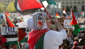 Palestinian supporters gather during a demonstration against the violence in Gaza, Tuesday, May 18, 2021 in Mississauga, Ontario