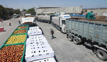 An aid convoy's trucks loaded with supplies send by Long Live Egypt Fund are seen at the Rafah border crossing between Egypt and the Gaza Strip, in this handout picture obtained by Reuters on May 23, 2021