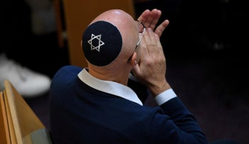 A man wears a kippah bearing the Star of David during a Peace and Solidarity with Israel rally at The Central Synagogue in Sydney, earlier this week.