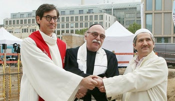 Pastor Gregor Hohberg, Rabbi Andreas Nachama and Imam Kadir Sanci pose during a ceremony of 'House Of One' building, May 2021.