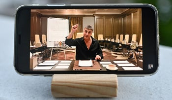 Sedat Peker speaking on his YouTube channel, showing on a mobile phone, this week in Istanbul.
