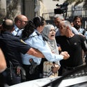 Palestinian protestors clash with police in Jerusalem on Wednesday.