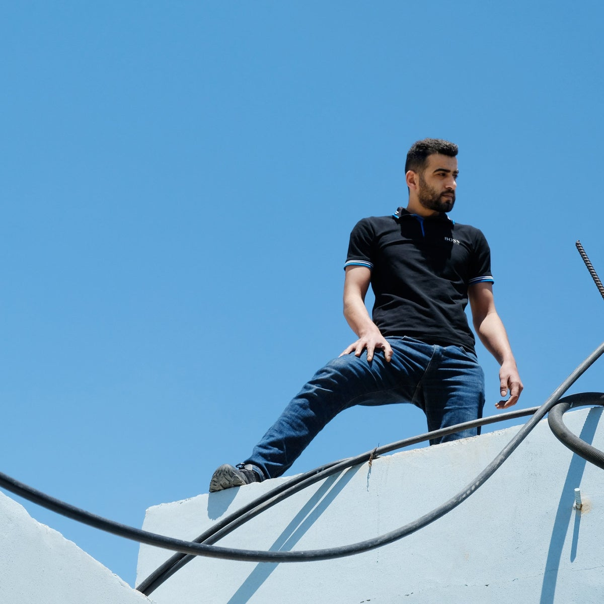Umar Titi on the roof in the Al-Fawwar refugee camp where his brother Hussein was killed. A few dozen meters separated the troops from their victim.