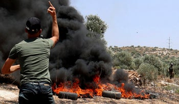 A Palestinian protester amid clashes with Israeli forces in the village of Beita, in the West Bank, on Friday.