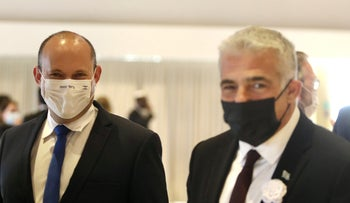 Natftali Bennett and Yair Lapid in the Knesset in April.