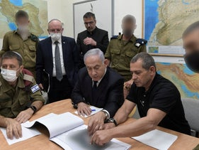 Prime Minister Netanyahu, center, meeting wtih Shin Bet director Nadav Argaman, right, at the Defense Ministry in Tel Aviv during the fighting fighting in Gaza.