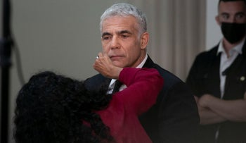 Yair Lapid prepares for a press statement in Tel Aviv, in early May.