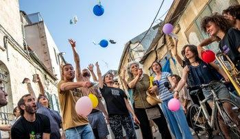 Israelis throw their masks as the requirement to wear masks outdoor is nixed in Jerusalem, last month.