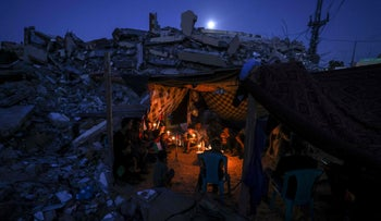 Palestinians sit in a tent  set up at the ruins of a building destroyed in Israeli airstrikes, in Beit Lahia in the Gaza Strip, last week.