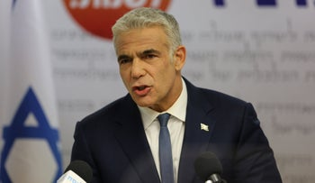 Yair Lapid at a Yesh Atid meeting, Monday.