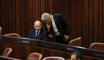 Naftali Bennett and Yair Lapid in the Knesset, June 2, 2021