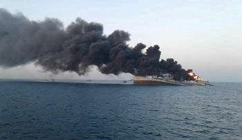 Smoke rises from Iran navy's largest ship in Jask port in the Gulf, Iran, June 2, 2021.