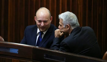 Yesh Atid leader Yair Lapid and Yamina leader Naftali Bennett in the Knesset, May 2021.
