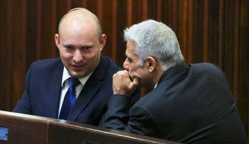 Naftali Bennett, left, speaking to Yair Lapid during a special session of the Knesset on Wednesday.