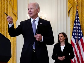Kamala Harris watches as Joe Biden takes a question from a reporter at the White House, last month.